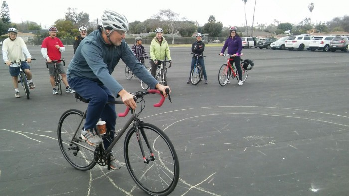 School Cycling Instructors (SCI) learn bicycle handling skills and cycling methodology for use during Professional Development. Steven Reichlin demonstrates components to perform a Figure 8. L - R: Crystal Mendez, Nathalie Winiarski, Johanna Iraheta & Alison Kendall.