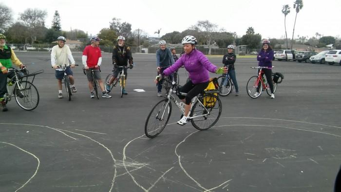 "Jayne Ishii shows fellow School Cycling Instructors skill-building methodology to a smooth Figure ""8"". Watching L - R: Jon Spangler, Dana Sherman, Jim Rowton-Instructor, Henry Granville, Steven Reichlin, Crystal Mendez, Johanna Iraheta & Alison Kendall."