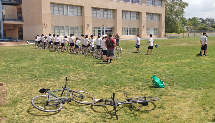 "Garnsey High School students listen to ""Slow Race"" instructions"
